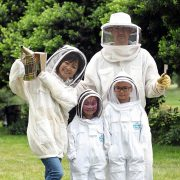 Getting Suited Up to Visit Our Bee Hives